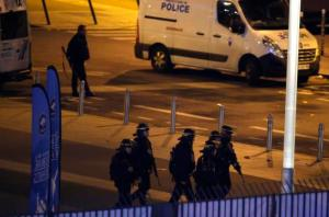 Police officers take position outside the Stade de France stadium after the international friendly soccer France against Germany, Friday, Nov. 13, 2015 in Saint Denis, outside Paris. At least 35 people were killed in shootings and explosions around Paris, many of them in a popular theater where patrons were taken hostage, police and medical officials said Friday.  Two explosions were heard outside the Stade de France stadium. (AP Photo/Michel Euler)
