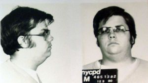 A mug-shot of Mark David Chapman, who shot and killed John Lennon, is displayed on the 25th anniversary of Lennon's death at the NYPD in New York December 8, 2005. Chapman is currently imprisoned at Attica State Prison in New York, serving a 20-year-to-life sentence after pleading guilty to 2nd degree murder. ??? USE ONLY